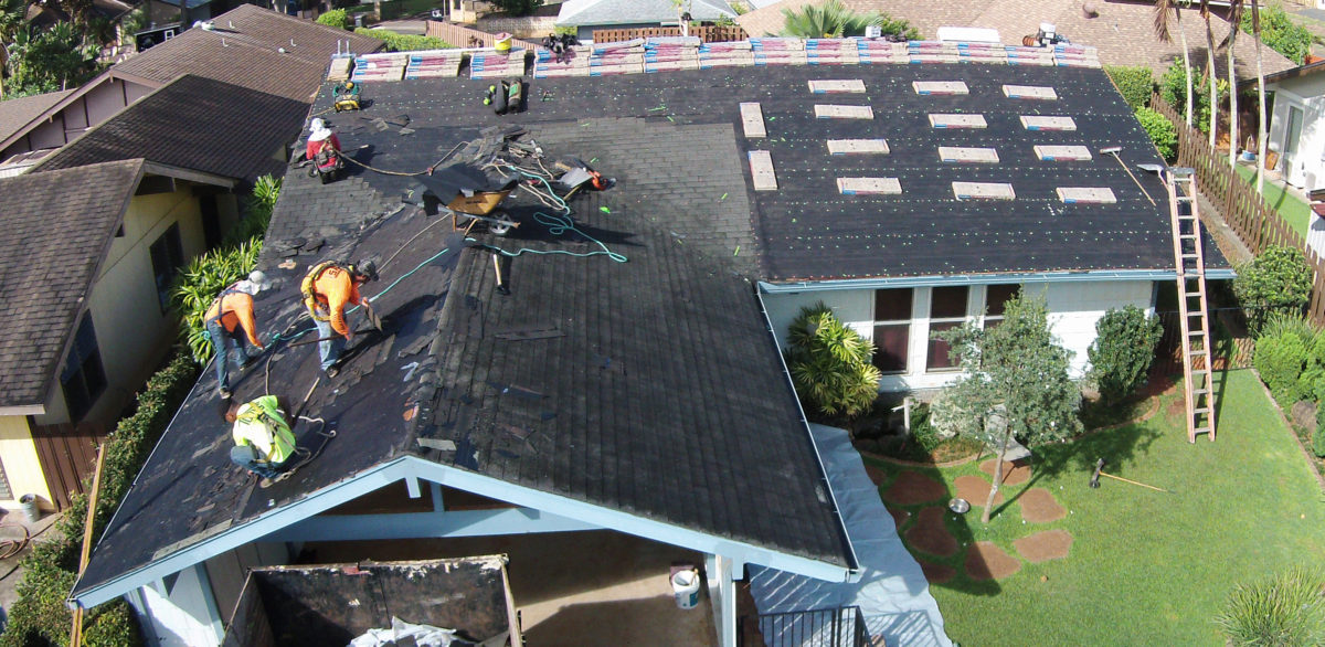 torys-reroofing-blue-house